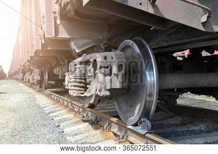 A Train Carrying Industrial Goods. The Wheels Of The Car.