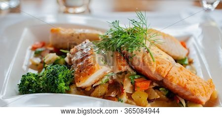 Fish Fillets With Fried Potatoes On A Plate With The Main Course