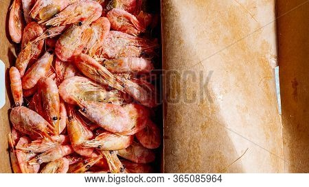 Freshly Frozen Shrimps In Paper Box Package Close-up Top View