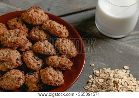 Oatmeal Cookies With A Glass Of Milk In The Background And Oatmeal