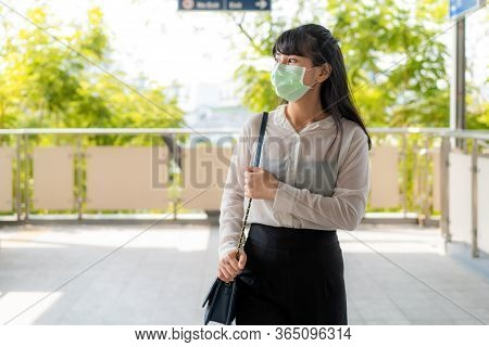 Young Stress Asian Businesswoman In White Shirt Going To Work In Pollution City She Wears Protection