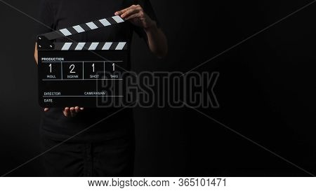Hand Is Holding Clap Board Or Movie Slate With Write In Number Use In Video Production And Movie Ind