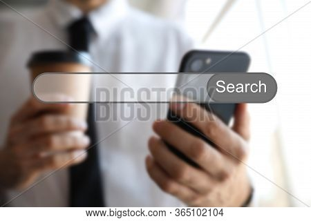 Search Bar Of Internet Browser And Man Using Smartphone Indoors, Closeup
