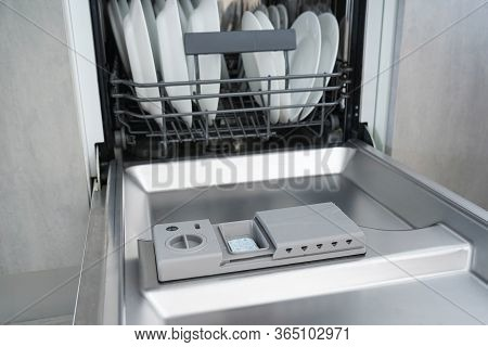 Open Dishwasher With Clean Dishes, Close-up. Dishwasher.