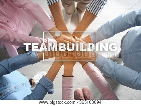 People Holding Hands Together, Top View. Teambuilding Concept