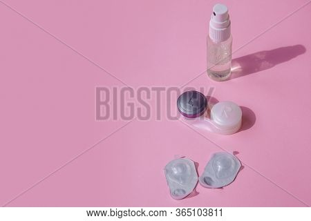 Contact Lens Kit. The Pink Table Is A Spray For Disinfecting Hands, A Container For The Lenses And B