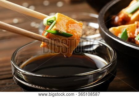 Mapo Tofu Dish Of Soybean Curd Piece Being Held In Chopsticks