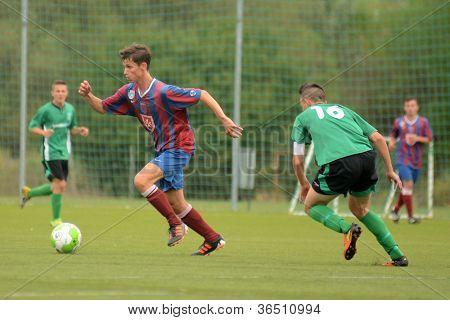 KAPOSVAR, HUNGARY - SEPTEMBER 1: Konrad Kiss (16) in action at the Hungarian National Championship under 18 game between Kaposvar (green) and Videoton (blue) September 1, 2012 in Kaposvar, Hungary.