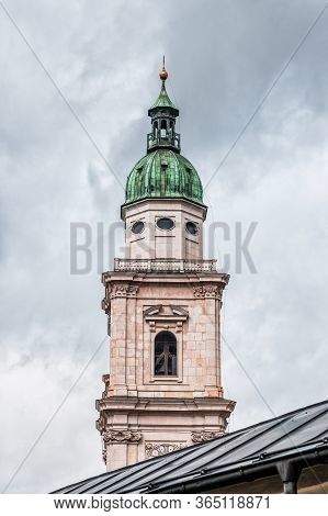 Steeple With Onion Dome Of St. Peter Abbey In Old Town Of Salzburg, Austria