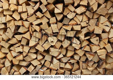 A Heap Of Chopped Firewood In Woodpile