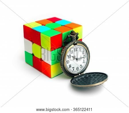 Italy, Milano - 10 April 2020: Rubik's Cube Puzzle And Antique Pocket Watch, Isolated On White Backg