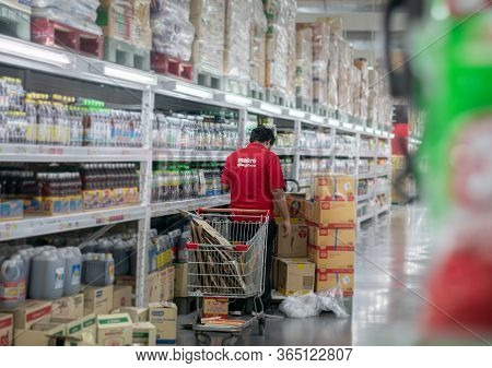 Bangkok, Thailand - May 07: Unidentified Employee Stocks Inventory In The Aisle Of Makro Supermarket