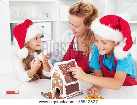 Making a gingerbread cookie house with the kids at christmas time