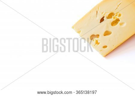 Maasdam Cheese On A White With Copy Space.
