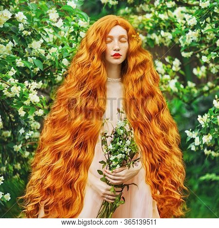 Red Curly Hair. Young Beautiful Red-haired Girl With Very Long Curly Hair With Freckles On Her Face.