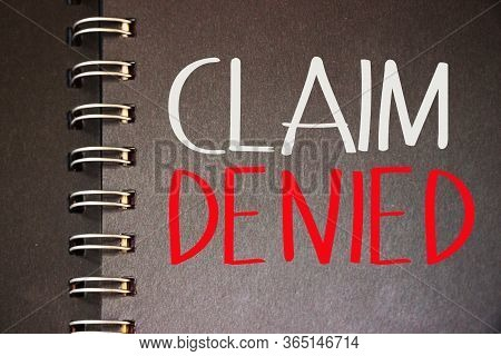 Claim Denied Words On Page Of Spiral Copybook, White And Red On Black. Application Rejected Business
