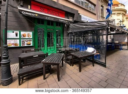 Bucharest, Romania - May 05, 2020: Tables And Chairs Are Stored In Front Of A Restaurant Temporary C