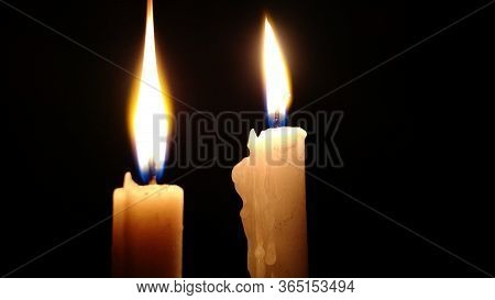 Candles Lighting A Student's Room In Full Power Outage