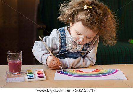 Happy Little Girl Paints A Rainbow. Everything Will Be Alright. Creative Leisure For Children.  Pres