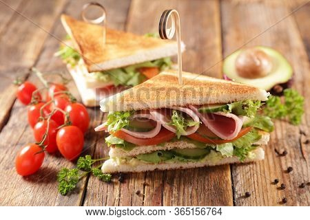 club sandwich- toasted sandwich with ham, tomato, lettuce and cucumber