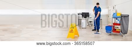 Professional Floor Cleaning Service. Janitor Mopping Office
