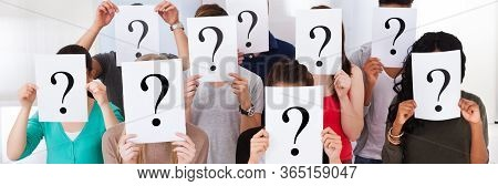Confused Student Group Holding Question Marks Asking Questions
