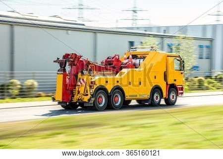 Transport Of Evacuation Of Cars , Road Assistance Service. Yellow Tow Truck