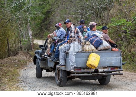 May 2, 2020 Ocoa, Dominican Republic. Dramatic Image Of Dominicans Riding On A Truck In The Mountain