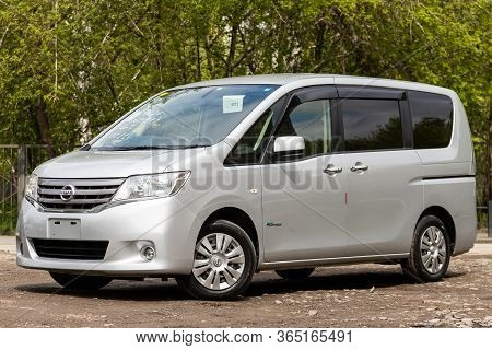 Novosibirsk/ Russia - May 02 2020:  Silver Nissan Serena,  Front View.  Modern Seven-seater Minivan