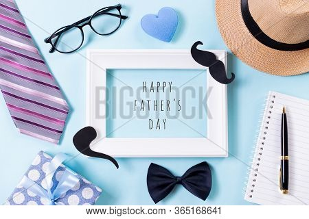 Happy Fathers Day Concept. Top View Of Tie, Beautiful Gift Box, Hat, White Picture Frame With Happy