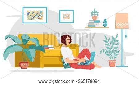 Young Woman Is Sitting Near The Yellow Sofa And Working From Home With A Laptop. Cozy Modern Living