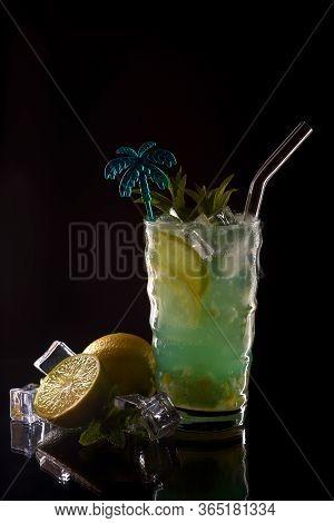 Mojito Cocktail At The Bar. Mojito Cocktail Over Black Background. Cocktail Mojito In The Nightclub