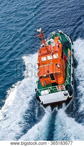 Kristiansand, Norway - July 19, 2017: A Pilot Boat Is Sailing At High Speed To A Ship At Sea To Brin