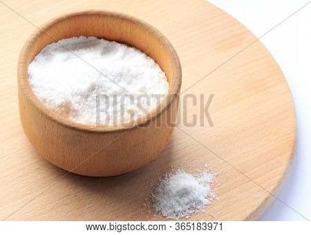 White Salt In A Wooden Bowl On A Wooden Board. Horizontal Photo. Salt Free Space