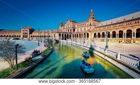 Seville, Spain - 10 February 2020 : Plaza De Espana Spain Square With Boats On The Canal In Beautifu