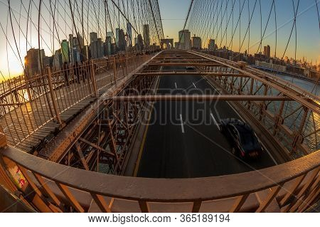 New York, Usa - March 9, 2020: Large Angle View Of Brooklyn Bridge In Afternoon Light With Tourists