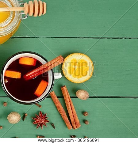 Mulled Wine In White Rustic Mugs With Spices And Citrus Fruit. Free Space For Text.