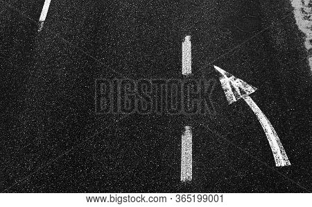 Road Marking In White Paint On The Pavement. Arrow Signsas Road Markings