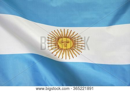 Fabric Texture Flag Of Argentina. Flag Of Argentina Waving In The Wind. Argentina Flag Is Depicted O