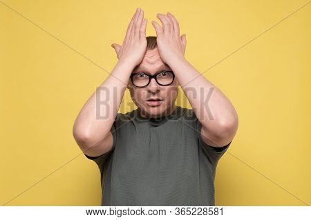 Man Pressing Hands To Head Panicking Being In Perplexed Situation