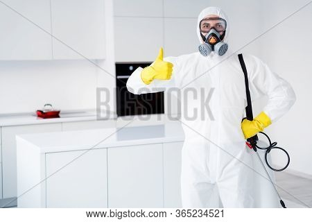 Dont Worry We Kill Covid19. Serious Successful Cleaner Worker Guy In Yellow Gloves Show Thumb Up Sig