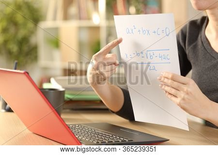 Close Up Of Teacher Woman Hands Teaching Online Lesson With Laptop On Videocall Stting On A Desk At