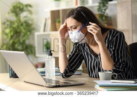 Sad Telemarketer Looking Laptop Wearing Mask On Covid-19 Quarantine Working At Homeoffice