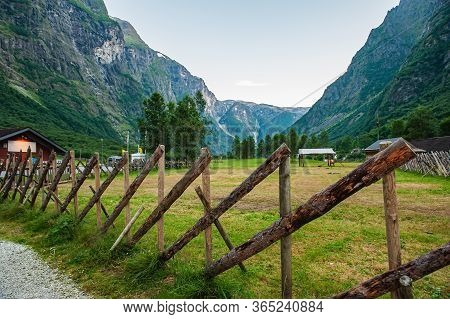 A Stylized Fence Of The Ancient Vikings. Beautiful Idyllic Mountain Landscape. Gudvangen Is A Popula
