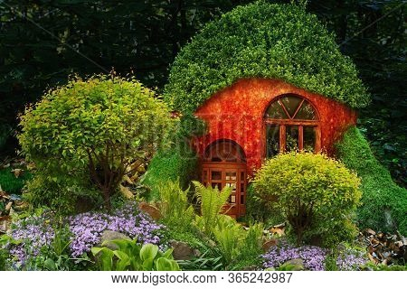 Fruit Fairy House With A Window, A Door And A Roof Of Leaves In The Moss In The Forest With A Beauti