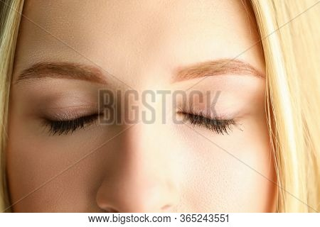 Closed Eyes Of Beautiful Blonde Woman In Morning Sunshine Close-up