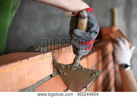 Builder With Spatula To Remove Excess Cement. Wall Area Calculation. Competent Selection Technology