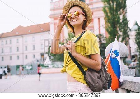 Woman Tourist With Slovenian Flag In Ljubljana, Slovenia, Europe.