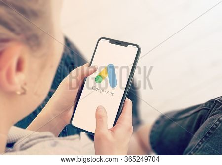 Kyiv, Ukraine-january, 2020: Google Ads On Smart Phone Screen. Young Girl Pointing Or Google Ads Dur