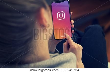 Kyiv, Ukraine-january, 2020: Instagram On Smartphone Screen. Young Girl Pointing Or Texting Smart Ph